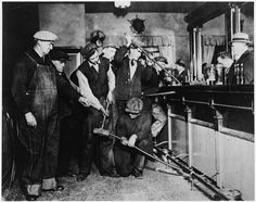 This is an image of Prohibition agents destroying a bar. Description from pinterest.com. I searched for this on bing.com/images
