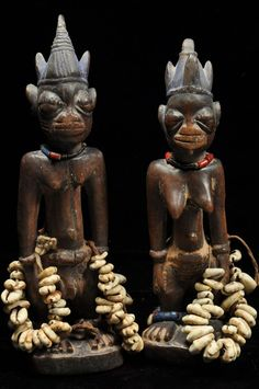 Africa | Ibeji Twin Figures from the Yoruba people of Nigeria | Wood, glass beads and shells.