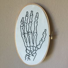 Vintage medical skeleton hand illustration hand embroidered in large oval hoop, finger bones, macabre wall art, oval embroidery home decor
