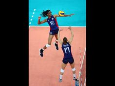 Great Shot!  USA middle blocker Foluke Akinradewo (16) receives the set from setter Courtney Thompson (17) in the women's indoor volleyball quarterfinal match against the Dominican Republic