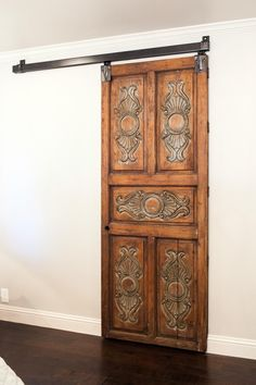 As seen on Fixer Upper, Joanna installed this antique door with sliding barn-door hardware for a distinctive accent for the master closet.