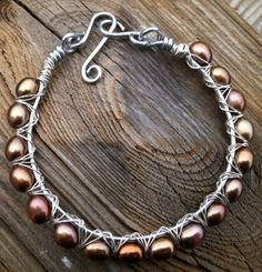 Wire wrapped bracelet with pearls $20