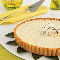 Serve this elegant tart during weekend brunch or after dinner—it's ideal anytime, with a coconut-shortbread crust and creamy filling flecked with grated lemon, lime and orange peel. Get the recipe. Low Fat Desserts, Lime Desserts, Easy Desserts, Dessert Recipes, Tart Recipes, Sweet Recipes, Lemon Recipes, Citrus Tart, Superbowl Desserts