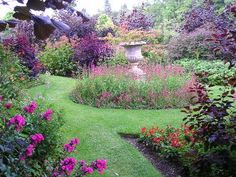 Urn is focal point of beautifully appointed garden...