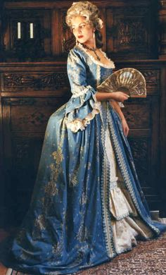 This dress in a radiant blue cotton jacquard material with golden pattern is tailored from an original dress-pattern from the later rococo period under Louis XVI. It is worn with the, typical of the time, pannier (hooped skirt). The underskirt and sleeve-linings are from an ivory coloured silk-brocade with floral patterning.