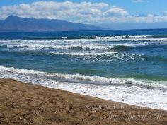 The Lopa beach waves…with Maui in the background