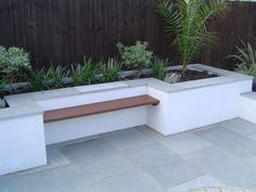 Urban Garden Design Kota Blue Limestone Paving used in an urban garden. The steel blue/grey colouring of the stone compliments the white rendering and wooden bench perfectly. Back Garden Design, Modern Garden Design, Contemporary Garden, Limestone Patio, Low Maintenance Garden Design, Planter Bench, Garden Paving, Outside Patio, Modern Planters