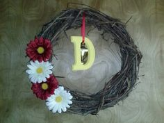 Our wreath! Easy DIY wreath for spring! ~JAA Just add flowers, paint a single wooden letter and attach with a ribbon!