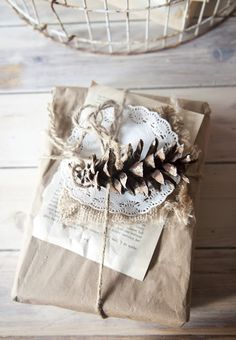 All my favorite things... wrapped.  Kraft paper, book pages, burlap, doilies, pine cones and twine.