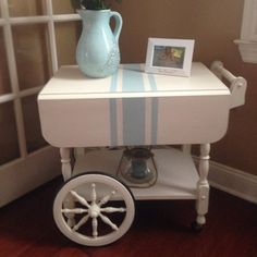 Hand painted vintage tea cart. This is painted antique white with a aqua blue sack stripe. A truly unique piece that would look pretty in a dining ... image 1