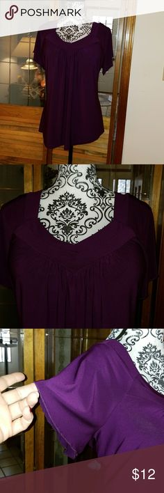 Perseption Woman blouse EUC. Rich plum colored Perseption Woman blouse. Short sleeves with a slight ruffle. Beautiful v neck pleated neckline with gathering just below. 92% polyester/8% spandex. Lightweight and flattering. Great for office or evening paired with trousers or a skirt. Perseption Tops Blouses