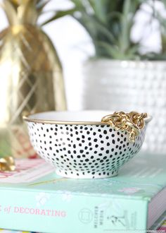 A bowl, Sharpie, and a gold leaf paint pen are all you need to create this chic DIY. It's the perfect catchall for jewelry, paper clips, or anything else!