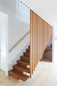 Extraordinary elements of contemporary design are brought to life through Heartington Road's striking features. A Victorian Ash timber slat balustrade creates a remarkable illusion of suspended two third -closed treads inside this residence. Brisbane, Melbourne, Wall Railing, Timber Slats, Laying Decking, Australia Tourism, Dutch East Indies, Airlie Beach, Metal Clock