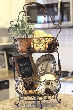 fall decorations for the kitchen. Love the wire tiered stand, looks so classy.