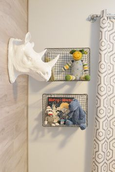 in this corner: hank's big boy room featuring a laminate wood wall, plumbing pipe curtain rod, and wire baskets for shelving.