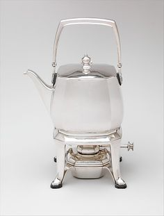 Kettle and stand Maker: Tiffany & Co. Date: 1928 Geography: Mid-Atlantic, New York, New York, United States Culture: American Medium: Silver, wood American Wings, Maker Culture, Blue Books, Large Art, Old And New, Kettle, Metal Working, Tiffany, Metropolitan Museum