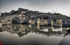The Twin Bridges at the Canal Town of Xitang, Zhejiang, China 西塘双桥 | por William Yu Photography / Photo Workshops