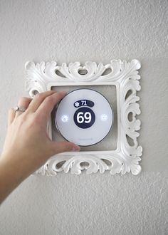 Add a decorative frame around your thermostat to make it a little bit more fun to look at - This thermostat is controlled by an app on your phone, too!  #Lyric #sponsored