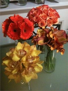 Single Flower Bouquets in Shades of Orange. Clockwise from Top Right: Roses, Calla Lilies, Cymbidium Orchids