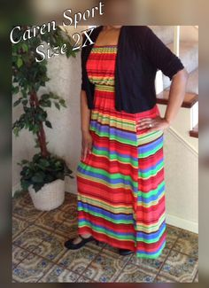 """This is a lovely plus size maxi dress ready for the warm weather. The dress is made by the Caren Port brand. It is strapless with no sleeves, but can be worn with a bolero as shown n the photo. It is striped and multi-colored, long in length, has an elastic waist and is made from 95% polyester and 5% spandex.    The dress is a size 2X with the following measurements:    Waist: 32"""" with lots of elastic stretch    Bust: 34"""" with lots of elastic stretch    Dress Length: 51""""    This item ships…"""