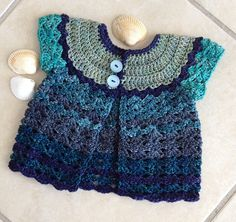 Ravelry: chitweed's Patty Cake Cardi. This is A FREE Crochet baby sweater Pattern by Michele DuNaier.  It's an easy pattern and is well written. Notes on this particular project done in DKTwist yarn by Madelinetosh.