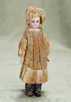 Sonneberg bisque doll in the French manner, w/original costume