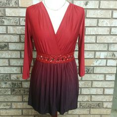Red beaded waist blouse Pretty red blouse...3/4 sleeves...colors get darker on bottom...long length...beaded waist..some beads loose and could be tacked tighter but can't see any missing.  Size Small Fashion Bug Tops Blouses
