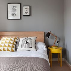 Simple but functional bedroom with bright yellow Ikea 'Stockholm' side table as nightstand @studiomorton