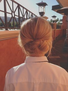My classy work up-do!  Tease hair, pin half up, take remaining hair and twist into a side bun and pin. Hairspray generously.