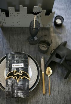 gotham city halloween party // set the table with costumes all ready for guests #batman #gotham #halloween
