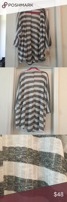 Black & White Striped LuLaRoe Lindsay Kimono Large New with tags LuLaRoe Lindsay kimono in large. Lightweight knit in black and white stripes, great for summer. Runs big, this is a size large, I usually wear a 1X -2X. LuLaRoe Sweaters Cardigans