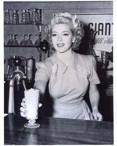 Lana Turner, beautiful American actress, was discovered waiting on customers at Swabs drugstore!
