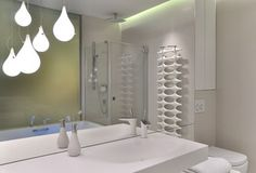 Mirror wall, pendant light, white tap
