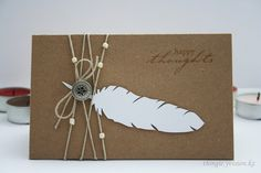 handmade card ... dark kraft with a bright white die cut feather ... luv the twine wrap with beads ... great card!!