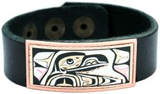 Remarkable handmade bracelets have copper artwork that is silver plated and diamond cut, then inlaid on these unique leather bracelets in Northwest Native totemic raven design. The raven is the most important of all creatures to the West Coast Native People. The raven symbolizes creation, prestige and knowledge. The raven is noted for placing the sun into the sky and fish into the ocean.