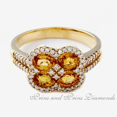 There are 4 x yellow sapphires and 0.33ct GH/VS – SI round brilliant cut diamonds pave set in an 18k yellow gold ring