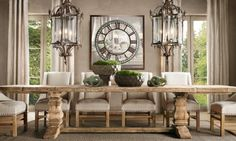 Love the rustic table, the hanging lanterns, the off-white linen dining chairs and drapes, and mirrored wall clock by Gloria Garcia