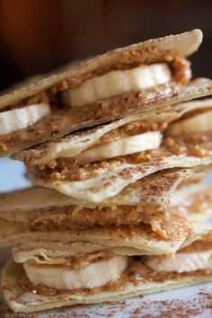 """Almond Butter & Banana """"Quesadilla""""  Ingredients  4 white or yellow corn tortillas  1/4 cup almond butter – or you may use peanut butter or a seed butter if there's a nut allergy  1 banana, peeled  1 tablespoon cocoa powder – optional  1 tablespoon powdered sugar – optional"""