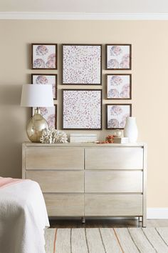 Soften your room's decor with hushed tones and organic textures. The subdued colors of floral, watercolor-like artwork are reflected in a mercury glass table lamp.