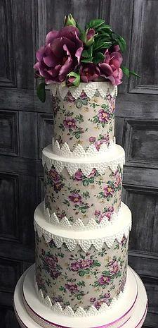 vintage rose wedding cake with deep pink sugar flowers