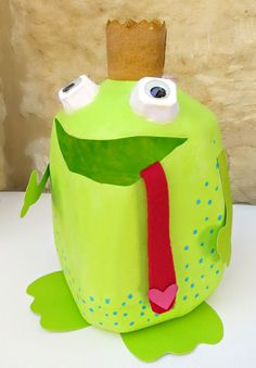 Make a Valentine Holder from a Milk Container. This frog prince captures hearts, not flies! Super adorable DIY Valentine's Day Card Box holder or candy/treat box idea! Such a cute craft for your kids classroom Valentines party at school! #plaidcrafts #modpodge #applebarrel
