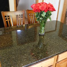 We updated these existing kitchen cabinets with new Ubatuba granite countertops with a small ogee edge on the perimeter and island.