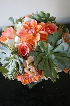 if youre liking your colors only being mint maybe add a hint of coral with the bouquets?...Orange Wedding Flowers coral peach wedding flowers mint succulents