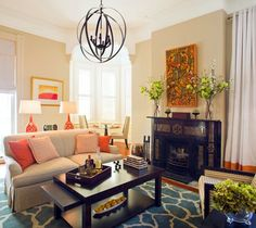Neutral living room with blue and orange