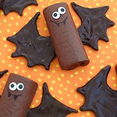 Pipe some chocolate wings onto a chocolate snack cake to make a cute bat treat for Halloween.