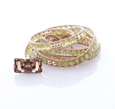 Wrap Bracelet: 14Kt Gold Beads with Peridot and Swavorski Crystal Button by Jonti Cameron. Why not treat a friend to a glam friendship bracelet this Christmas?