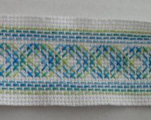 Embroidered bookmark - Swedish weaving - Pseudo-Argyle pattern in blues and greens