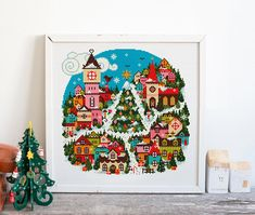 Welcome to Christmas town! A fun bright place covered in snow and festive cheer. This festive stitch is a great project to get you in the mood for December.  This is all whole stitches so great for all abilities.  140 stitches wide x 141 stitches high  Finished stitched area: 14 ct aida -