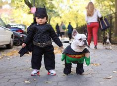 I love the idea of dressing up your child's pet to coordinate with your child's costume.  Here's Batman and Robin. #puppied