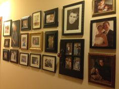 Got some 57 cent copies made at Walmart, put the pics in garage sale frames, and voila! The family gallery wall..... <3
